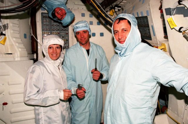 In the Orbiter Processing Facility Bay 3, during the Crew Equipment Interface Test (CEIT) for mission STS-93, crew members pose for a photograph . From left they are Mission Commander Eileen M. Collins, Pilot Jeffrey S. Ashby, and Mission Specialist Michel Tognini of France. Above Ashby's head is Mission Specialist Catherine G. Coleman. Not shown is Mission Specialist Steven A. Hawley. Collins is the first woman to serve as a mission commander on a shuttle flight. The CEIT provides an opportunity for crew members to check equipment and facilities that will be aboard the orbiter during their mission. The STS-93 mission will deploy the Advanced X-ray Astrophysics Facility (AXAF), which comprises three major elements: the spacecraft, the telescope, and the science instrument module (SIM). AXAF will allow scientists from around the world to obtain unprecedented X-ray images of a variety of high-energy objects to help understand the structure and evolution of the universe. Targeted date for the launch of STS-93 is March 18, 1999 KSC-98pc1692