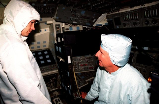 In the Orbiter Processing Facility Bay 3, aboard the orbiter Columbia, STS-93 Mission Commander Eileen M. Collins listens to Mission Specialist Steven A. Hawley during the Crew Equipment Interface Test (CEIT). Collins is the first woman to serve as a mission commander on a shuttle flight. The CEIT provides an opportunity for crew members to check equipment and facilities that will be aboard the orbiter during their mission. The rest of the crew members are Pilot Jeffrey S. Ashby, Mission Specialist Catherine G. Coleman, and Mission Specialist Michel Tognini of France. The STS-93 mission will deploy the Advanced X-ray Astrophysics Facility (AXAF), which comprises three major elements: the spacecraft, the telescope, and the science instrument module (SIM). AXAF will allow scientists from around the world to obtain unprecedented X-ray images of a variety of high-energy objects to help understand the structure and evolution of the universe. Targeted date for the launch of STS-93 is March 18, 1999 KSC-98pc1693