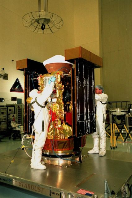 """In the Payload Hazardous Servicing Facility, Randy Scott (left) and Pat Wedeman (right), with Lockheed Martin Astronautics, check the insulation material on the <a href=""""http://www-pao.ksc.nasa.gov/kscpao/captions/subjects/stardust.htm"""">Stardust</a> spacecraft. Stardust will use a unique medium called aerogel to capture comet particles flying off the nucleus of comet Wild 2 in January 2004, plus collect interstellar dust for later analysis. The collected samples will return to Earth in the SRC to be jettisoned as it swings by Earth in January 2006. Stardust is scheduled to be launched aboard a Boeing Delta 7426 rocket from Complex 17, Cape Canaveral Air Station, on Feb. 6, 1999 KSC-98pc1894"""