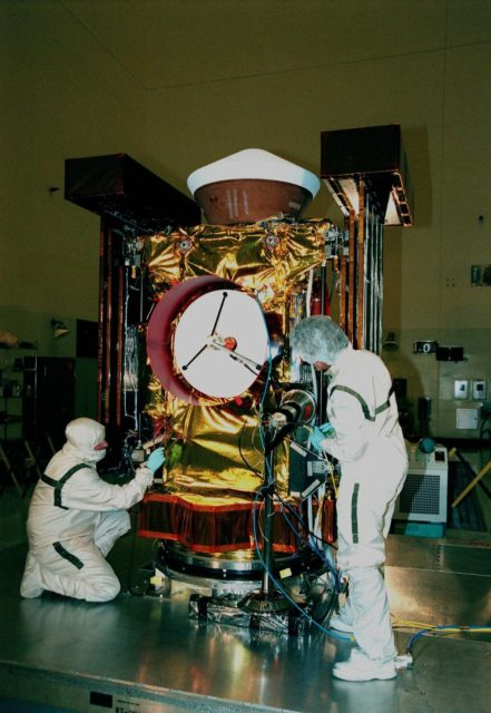"""In the Payload Hazardous Servicing Facility, Randy Scott (left) and Linda Townsend (right), with Lockheed Martin Astronautics, make a final check of the <a href=""""http://www-pao.ksc.nasa.gov/kscpao/captions/subjects/stardust.htm"""">Stardust</a> spacecraft. Stardust will use a unique medium called aerogel to capture comet particles flying off the nucleus of comet Wild 2 in January 2004, plus collect interstellar dust for later analysis. The collected samples will return to Earth in the SRC to be jettisoned as it swings by Earth in January 2006. Stardust is scheduled to be launched aboard a Boeing Delta 7426 rocket from Complex 17, Cape Canaveral Air Station, on Feb. 6, 1999 KSC-98pc1896"""
