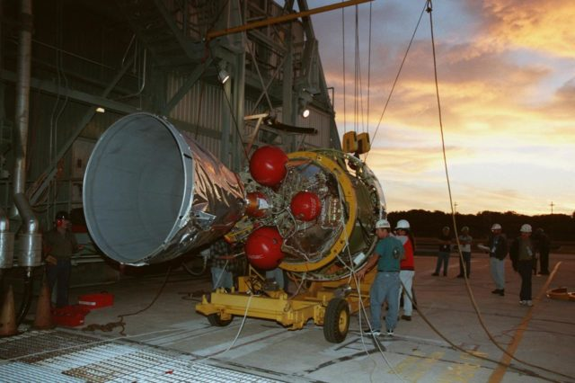 """At Pad 17A, Cape Canaveral Air Station, the second stage of a Boeing Delta II rocket arrives for mating with the first stage. The rocket is targeted for launch on Feb. 6, carrying the <a href=""""http://www-pao.ksc.nasa.gov/kscpao/captions/subjects/stardust.htm"""">Stardust </a> spacecraft into space for a close encounter with the comet Wild 2 in January 2004. Using a substance called aerogel, Stardust will capture comet particles flying off the nucleus of the comet, plus collect interstellar dust for later analysis. The collected samples will return to Earth in a sample return capsule to be jettisoned as Stardust swings by Earth in January 2006 KSC-99pc56"""