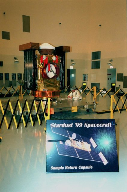 In the Payload Hazardous Servicing Facility, the spacecraft Stardust is on display for a media presentation. Stardust is targeted for launch on Feb. 6 aboard a Boeing Delta II rocket from Launch Pad 17-A, Cape Canaveral Air Station. The spacecraft is destined for a close encounter with the comet Wild 2 in January 2004. Using a silicon-based substance called aerogel, Stardust will capture comet particles flying off the nucleus of the comet. The spacecraft also will bring back samples of interstellar dust. These materials consist of ancient pre-solar interstellar grains and other remnants left over from the formation of the solar system. Scientists expect their analysis to provide important insights into the evolution of the sun and planets and possibly into the origin of life itself. The collected samples will return to Earth in a sample return capsule (the white-topped, blunt-nosed cone seen on the top of the spacecraft) to be jettisoned as Stardust swings by Earth in January 2006 KSC-99pc0094