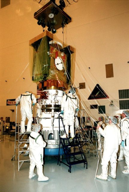 In the Payload Hazardous Servicing Facility, workers check the mating of the spacecraft Stardust (above) with the third stage of a Boeing Delta II rocket (below). Targeted for launch Feb. 6 from Launch Pad 17-A, Cape Canaveral Air Station, aboard the Delta II rocket, the spacecraft is destined for a close encounter with the comet Wild 2 in January 2004. Using a silicon-based substance called aerogel, Stardust will capture comet particles flying off the nucleus of the comet. The spacecraft also will bring back samples of interstellar dust. These materials consist of ancient pre-solar interstellar grains and other remnants left over from the formation of the solar system. Scientists expect their analysis to provide important insights into the evolution of the sun and planets and possibly into the origin of life itself. The collected samples will return to Earth in a sample return capsule to be jettisoned as Stardust swings by Earth in January 2006 KSC-99pc0102