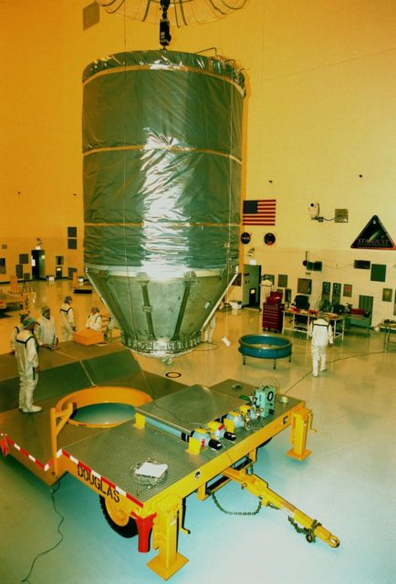 Completely enclosed in a protective canister, the spacecraft Stardust is moved by a crane toward a transporter in the Payload Hazardous Servicing Facility. Stardust is being moved to Launch Pad 17-A, Cape Canaveral Air Station, for launch preparations. The spacecraft is targeted for liftoff on Feb. 6 aboard a Boeing Delta II rocket for a close encounter with the comet Wild 2 in January 2004. Using a silicon-based substance called aerogel, Stardust will capture comet particles flying off the nucleus of the comet. The spacecraft also will bring back samples of interstellar dust. These materials consist of ancient pre-solar interstellar grains and other remnants left over from the formation of the solar system. Scientists expect their analysis to provide important insights into the evolution of the sun and planets and possibly into the origin of life itself. The collected samples will return to Earth in a sample return capsule to be jettisoned as Stardust swings by Earth in January 2006 KSC-99pc0124