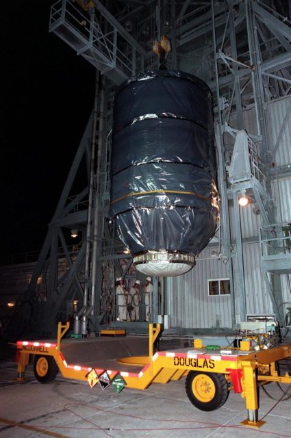 At Launch Pad 17-A, Cape Canaveral Air Station, the Stardust spacecraft, attached to the third stage of a Boeing Delta II rocket, is lifted up the launch tower. The second and third stages of the rocket will be mated next as preparations continue for liftoff on Feb. 6. Stardust is destined for a close encounter with the comet Wild 2 in January 2004. Using a silicon-based substance called aerogel, Stardust will capture comet particles flying off the nucleus of the comet. The spacecraft also will bring back samples of interstellar dust. These materials consist of ancient pre-solar interstellar grains and other remnants left over from the formation of the solar system. Scientists expect their analysis to provide important insights into the evolution of the sun and planets and possibly into the origin of life itself. The collected samples will return to Earth in a sample return capsule to be jettisoned as Stardust swings by Earth in January 2006 KSC-99pc0127