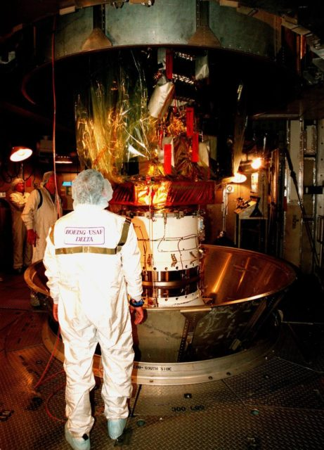 The protective canister is removed from around the Stardust spacecraft at Launch Pad 17-A, Cape Canaveral Air Station. Preparations continue for liftoff of the Boeing Delta II rocket carrying Stardust on Feb. 6. Stardust is destined for a close encounter with the comet Wild 2 in January 2004. Using a silicon-based substance called aerogel, Stardust will capture comet particles flying off the nucleus of the comet. The spacecraft also will bring back samples of interstellar dust. These materials consist of ancient pre-solar interstellar grains and other remnants left over from the formation of the solar system. Scientists expect their analysis to provide important insights into the evolution of the sun and planets and possibly into the origin of life itself. The collected samples will return to Earth in a sample return capsule to be jettisoned as Stardust swings by Earth in January 2006 KSC-99pc0134