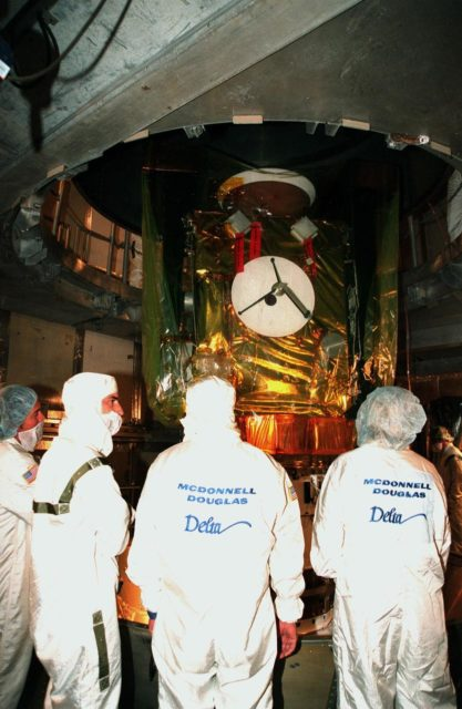 Workers watch as the protective canister surrounding the Stardust spacecraft is removed at Launch Pad 17-A, Cape Canaveral Air Station. Preparations continue for liftoff of the Boeing Delta II rocket carrying Stardust on Feb. 6. Stardust is destined for a close encounter with the comet Wild 2 in January 2004. Using a silicon-based substance called aerogel, Stardust will capture comet particles flying off the nucleus of the comet. The spacecraft also will bring back samples of interstellar dust. These materials consist of ancient pre-solar interstellar grains and other remnants left over from the formation of the solar system. Scientists expect their analysis to provide important insights into the evolution of the sun and planets and possibly into the origin of life itself. The collected samples will return to Earth in a sample return capsule to be jettisoned as Stardust swings by Earth in January 2006 KSC-99pc0135