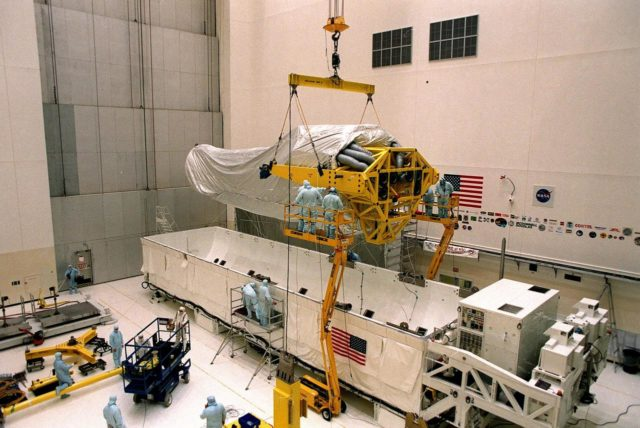 Inside the Vertical Processing Facility (VPF), the overhead crane lifts Chandra X-ray Observatory completely out of its protective container. While in the VPF, the telescope will undergo final installation of associated electronic components; it will also be tested, fueled and mated with the Inertial Upper Stage booster. A set of integrated tests will follow. Chandra is scheduled for launch July 9 aboard Space Shuttle Columbia, on mission STS-93 . Formerly called the Advanced X-ray Astrophysics Facility, Chandra comprises three major elements: the spacecraft, the science instrument module (SIM), and the world's most powerful X-ray telescope. Chandra will allow scientists from around the world to see previously invisible black holes and high-temperature gas clouds, giving the observatory the potential to rewrite the books on the structure and evolution of our universe KSC-99pc0172