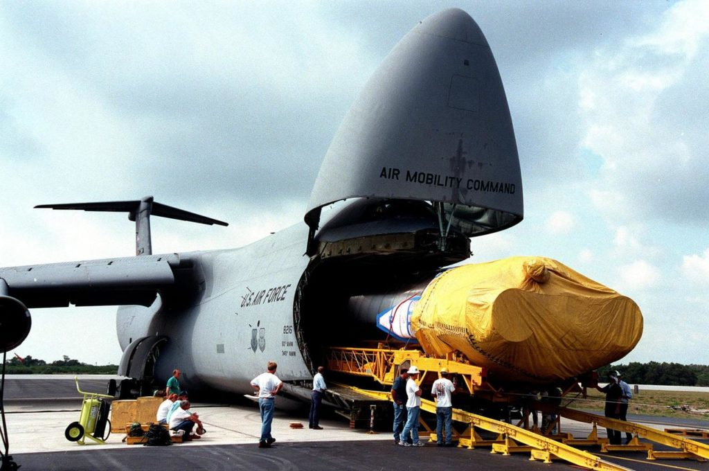 At Cape Canaveral Air Station, workers begin offloading an Atlas IIA rocket from a U.S. Air Force C-5c. The rocket is scheduled to launch the NASA GOES-L satellite from Launch Pad 36B on May 15. Once in orbit, the satellite will become GOES-11, joining GOES-8, GOES-9 and GOES-10 in space. The fourth of a new advanced series of geostationary weather satellites for the National Oceanic and Atmospheric Administration (NOAA), GOES-L is a three-axis inertially stabilized spacecraft that will provide pictures and perform atmospheric sounding at the same time. Once launched, the satellite will undergo checkout and then provide backup capabilities for the existing, aging operational satellites KSC-99pp0383