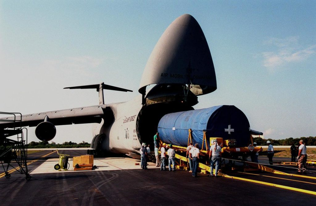 At Cape Canaveral Air Station, workers begin offloading a Centaur upper stage from a U.S. Air Force C-5c. After being mated with the Atlas IIA lower stage, the rocket is scheduled to launch the NASA GOES-L satellite from Launch Pad 36A on May 15. Once in orbit, the satellite will become GOES-11, joining GOES-8, GOES-9 and GOES-10 in space. The fourth of a new advanced series of geostationary weather satellites for the National Oceanic and Atmospheric Administration (NOAA), GOES-L is a three-axis inertially stabilized spacecraft that will provide pictures and perform atmospheric sounding at the same time. Once launched, the satellite will undergo checkout and then provide backup capabilities for the existing, aging operational satellites KSC-99pp0386
