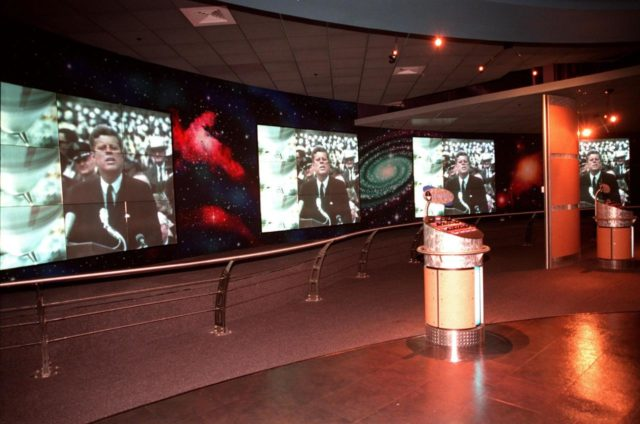 KENNEDY SPACE CENTER, FLA. -- Part of the $13 million expansion to KSC's Visitor Complex, the new information center welcomes visitors to the Gateway to the Universe. The five large video walls provide an orientation video, with an introduction to the range of activities and exhibits, and honor the center's namesake, President John F. Kennedy. Other new additions include a walk-through Robot Scouts exhibit, a wildlife exhibit, and the film Quest for Life in a new 300-seat theater, and an International Space Station-themed ticket plaza, featuring a structure of overhanging solar panels and astronauts performing assembly tasks. The KSC Visitor Complex was inaugurated three decades ago and is now one of the top five tourist attractions in Florida. It is located on S.R. 407, east of I-95, within the Merritt Island National Wildlife Refuge KSC-99pp0402