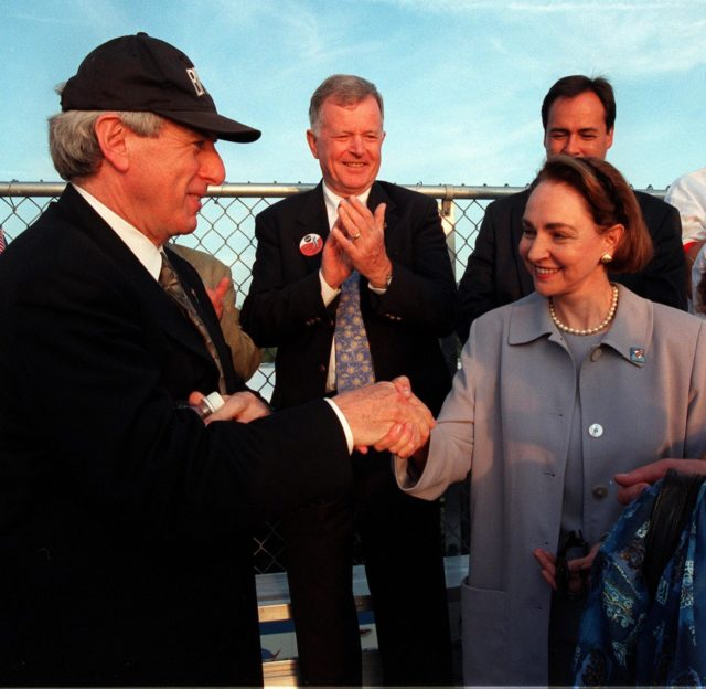 NASA Administrator Daniel Goldin (left) greets Mme. Aline Chretien, wife of the Canadian Prime Minister, at the launch of STS-96. Looking on in the background (between them) is former astronaut Jean-Loup Chretien (no relation), who flew on STS-86. Mme. Chretien attended the launch because one of the STs-96 crew is Mission Specialist Julie Payette, who represents the Canadian Space Agency. Space Shuttle Discovery launched on time at 6:49:42 a.m. EDT to begin a 10-day logistics and resupply mission for the International Space Station. Along with such payloads as a Russian crane, the Strela; a U.S.-built crane; the Spacehab Oceaneering Space System Box (SHOSS), a logistics items carrier; and STARSHINE, a student-involved experiment, Discovery carries about 4,000 pounds of supplies, to be stored aboard the station for use by future crews, including laptop computers, cameras, tools, spare parts, and clothing. The mission includes a space walk to attach the cranes to the outside of the ISS for use in future construction. Landing is expected at the SLF on June 6 about 1:58 a.m. EDT KSC-99pp0598