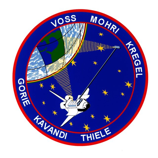 STS099-S-001 (June 1999) --- The STS-99 crew members designed the flight insignia for the Shuttle Radar Topography Mission (SRTM), the most ambitious Earth mapping mission to date. Two radar antennas, one located in the shuttle bay and the other located on the end of a 60-meter deployable mast, will be used during the mission to map Earth?s features. The goal is to provide a three-dimensional topographic map of the world?s surface up to the Arctic and Antarctic Circles. The clear portion of Earth illustrates the radar beams penetrating its cloudy atmosphere and the unique understanding of the home planet that is provided by space travel. The grid on Earth reflects the mapping character of the SRTM mission. The patch depicts the space shuttle Endeavour orbiting Earth in a star spangled universe. The rainbow along Earth?s horizon resembles an orbital sunrise. The crew deems the bright colors of the rainbow as symbolic of the bright future ahead because of human beings? venturing into space.    The NASA insignia design for space shuttle flights is reserved for use by the astronauts and for other official use as the NASA Administrator may authorize. Public availability has been approved only in the forms of illustrations by the various news media. When and if there is any change in this policy, which is not anticipated, the change will be publicly announced. Photo credit: NASA sts099-s-001