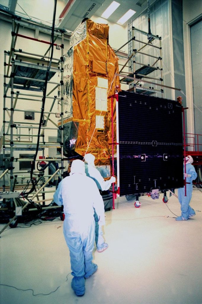 At Hangar AE, Cape Canaveral Air Station (CCAS), workers move a solar panel toward NASA's Far Ultraviolet Spectroscopic Explorer (FUSE) satellite before attaching it. FUSE was developed by The Johns Hopkins University under contract to Goddard Space Flight Center, Greenbelt, Md., to investigate the origin and evolution of the lightest elements in the universe hydrogen and deuterium. In addition, the FUSE satellite will examine the forces and process involved in the evolution of the galaxies, stars and planetary systems by investigating light in the far ultraviolet portion of the electromagnetic spectrum. FUSE is targeted for launch June 23 from Launch Pad 17A, CCAS, aboard a Boeing Delta II rocket KSC-99pp0664
