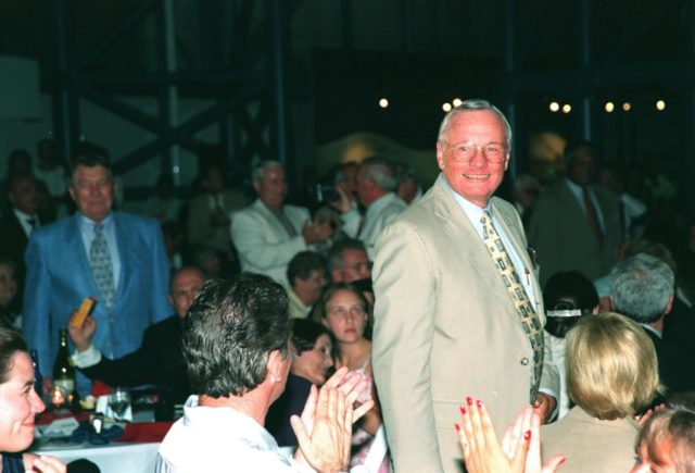 """KENNEDY SPACE CENTER, FLA. -- Former Apollo 11 astronaut Neil A. Armstrong stands to a round of applause after being introduced at the anniversary banquet honoring the Apollo team, the people who made the entire lunar landing program possible. The banquet was held in the Apollo/Saturn V Center, part of the KSC Visitor Complex. This is the 30th anniversary of the Apollo 11 launch and moon landing, July 16 and July 20, 1969. Neil Armstrong was the first man to set foot on the moon. He appeared at the banquet with other former astronauts Edwin """"Buzz"""" Aldrin, Gene Cernan, Walt Cunningham and others KSC-99pp0858"""