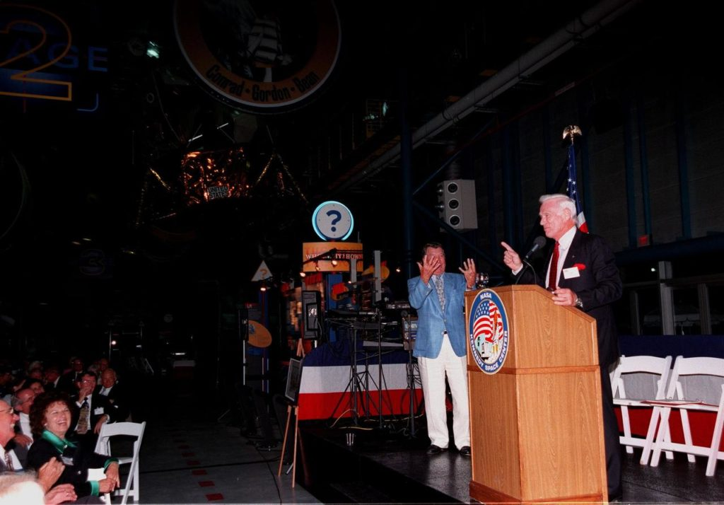 "KENNEDY SPACE CENTER, FLA. -- During an anniversary banquet honoring the Apollo program team, the people who made the entire lunar landing program possible, former Apollo astronaut Gene Cernan relates a humorous comment while Wally Schirra (background) gestures behind him. Cernan, who flew on Apollo 10 and 17, was the last man to walk on the moon; Schirra flew on Apollo 7. The banquet was held in the Apollo/Saturn V Center, part of the KSC Visitor Complex. This is the 30th anniversary of the Apollo 11 launch and moon landing, July 16 and July 20, 1969. Other guests at the banquet were former Apollo astronauts are Neil A. Armstrong and Edwin ""Buzz"" Aldrin who flew on Apollo 11, the launch of the first moon landing, and Walt Cunningham, who also flew on Apollo 7 KSC-99pp0877"
