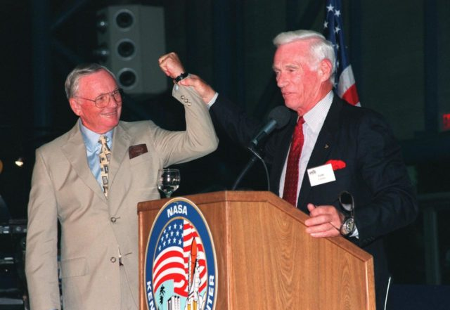 """KENNEDY SPACE CENTER, FLA. -- Former Apollo astronauts Neil Armstrong (left) and Gene Cernan entertain the audience during an anniversary banquet honoring the Apollo program team, the people who made the entire lunar landing program possible. The banquet was held in the Apollo/Saturn V Center, part of the KSC Visitor Complex. This is the 30th anniversary of the Apollo 11 launch and moon landing, July 16 and July 20, 1969. Other guests at the banquet were astronauts Wally Schirra, Edwin """"Buzz"""" Aldrin and Walt Cunningham. Neil Armstrong was the first man to walk on the moon; Gene Cernan was the last KSC-99pp0932"""