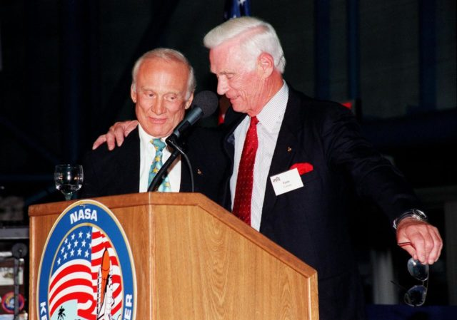 """KENNEDY SPACE CENTER, FLA. -- Former Apollo astronauts Edwin """"Buzz"""" Aldrin (left) and Gene Cernan share stories about their missions for an audience attending an anniversary banquet honoring the Apollo program team, the people who made the entire lunar landing program possible. The banquet was held in the Apollo/Saturn V Center, part of the KSC Visitor Complex. This is the 30th anniversary of the Apollo 11 launch and moon landing, July 16 and July 20, 1969. Other guests at the banquet were astronauts Wally Schirra, Gene Cernan and Walt Cunningham. Neil Armstrong was the first man to walk on the moon; Gene Cernan was the last KSC-99pp0933"""