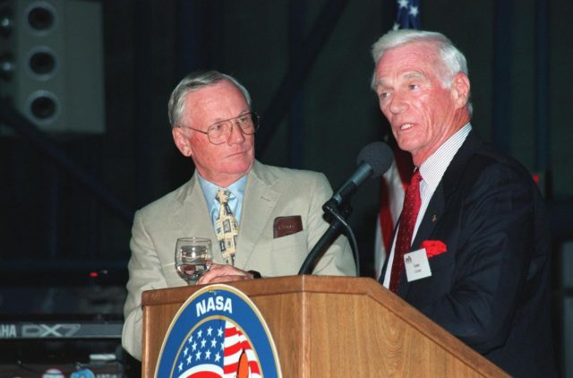 """KENNEDY SPACE CENTER, FLA. -- During an anniversary banquet honoring the Apollo program team, the people who made the entire lunar landing program possible, former Apollo astronauts Neil Armstrong (left) and Gene Cernan talk about their experiences. The banquet was held in the Apollo/Saturn V Center, part of the KSC Visitor Complex. This is the 30th anniversary of the Apollo 11 launch and moon landing, July 16 and July 20, 1969. Other guests at the banquet were astronauts Wally Schirra, Edwin """"Buzz"""" Aldrin and Walt Cunningham. Neil Armstrong was the first man to walk on the moon; Gene Cernan was the last KSC-99pp0936"""