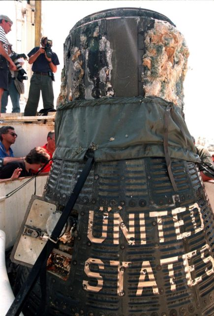 "KENNEDY SPACE CENTER, FLA. -- A close-up of the recently recovered Liberty Bell 7 Project Mercury capsule from the ocean floor shows the lettering ""United States"" still clearly visible on its side. Thirty-eight years ago, the capsule made a successful 16-minute suborbital flight, with astronaut Virgil ""Gus"" Grissom aboard, and splashed down in the Atlantic Ocean.  A prematurely jettisoned hatch caused the capsule to flood and a Marine rescue helicopter was unable to lift it.  It quickly sank to a three-mile depth.  Grissom was rescued but his spacecraft remained lost on the ocean floor, until now. In an expedition sponsored by the Discovery Channel, underwater salvage expert Curt Newport fulfilled a 14-year dream in finding and, after one abortive attempt, successfully raising the capsule and bringing it to Port Canaveral. The capsule is being moved to the Kansas Cosmosphere and Space Center in Hutchinson, Kansas,  where it will be restored for eventual public display. Newport has also been involved in salvage operations of the Space Shuttle Challenger and TWA Flight 800 that crashed off the coast of Long Island, N.Y. KSC-99pp1036"