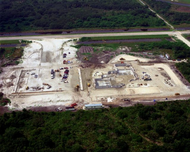 Looking southwest, this view shows ongoing construction of a multi-purpose hangar, which is part of the $8 million Reusable Launch Vehicle (RLV) Support Complex at Kennedy Space Center. Edging the construction is Sharkey Road, which parallels the landing strip of the Shuttle Landing Facility nearby. The RLV complex will include facilities for related ground support equipment and administrative/ technical support. It will be available to accommodate the Space Shuttle; the X-34 RLV technology demonstrator; the L-1011 carrier aircraft for Pegasus and X-34; and other RLV and X-vehicle programs. The complex is jointly funded by the Spaceport Florida Authority, NASA's Space Shuttle Program and KSC. The facility will be operational in early 2000. KSC-99PP-1047