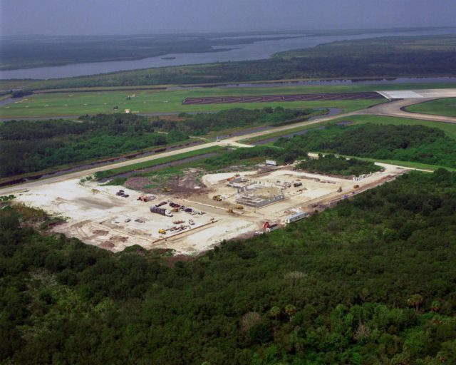 An aerial view shows the early construction of a multi-purpose hangar, which is part of the $8 million Reusable Launch Vehicle (RLV) Support Complex at Kennedy Space Center. In the background, toward the west, is Banana Creek, flowing into the Indian River Lagoon, and below it the Shuttle Landing Facility's landing strip. The RLV complex will also include facilities for related ground support equipment and administrative/ technical support. It will be available to accommodate the Space Shuttle; the X-34 RLV technology demonstrator; the L-1011 carrier aircraft for Pegasus and X-34; and other RLV and X-vehicle programs. The complex is jointly funded by the Spaceport Florida Authority, NASA's Space Shuttle Program and KSC. The facility will be operational in early 2000 KSC-99pp1045