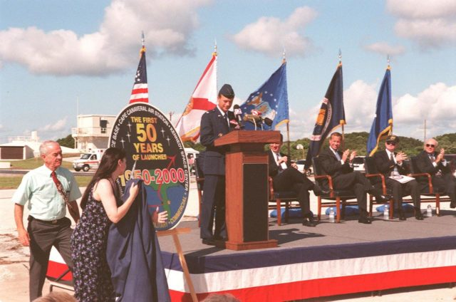 At Cape Canaveral Air Station's (CCAS) Complex 3/4, officials held a ceremony kicking off a year-long series of events commemorating 50 years of launches from the Space Coast that began with the Bumper rockets. At left is Jim Thompson, who is with CCAS. Unveiling the 50th anniversary logo at left is the artist Darlene Egli. On stage, from left to right, are Lt. Col. Randall K. Horn, Commander, CCAS; Congressman David Weldon, 15th Congressional District of the State of Florida; Lieutenant Governor of the State of Florida Frank T. Brogan; Center Director Roy D. Bridges; and Executive Director Edward F. Gormel, Joint Performance Management Office. Also present (but not seen) is Brig. Gen. Donald P. Pettit, Commander, 45th Space Wing. After six Bumper launches at White Sands Proving Grounds, N.M., and a failed Bumper 7, a successful Bumper 8 lifted off July 24, 1950, from Complex 3/4 to conduct aerodynamic investigations around Mach 7 at relatively low altitudes. The kick-off event also inaugurated a student art contest to design a commemorative etching. The winning artwork will be permanently displayed on a 24-inch black granite square in the U.S. space Walk Hall of Fame in Titusville, Fla KSC-99pp1065