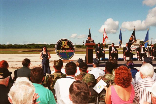 At Cape Canaveral Air Station's (CCAS) Complex 3/4, officials held a ceremony kicking off a year-long series of events commemorating 50 years of launches from the Space Coast that began with the Bumper rockets. At left is artist Darlene Egli who designed the 50th anniversary logo next to her. On stage, from left to right, are Lt. Col. Randall K. Horn, Commander, CCAS; Brig. Gen. Donald P. Pettit, Commander, 45th Space Wing; Congressman David Weldon, 15th Congressional District of the State of Florida; Lieutenant Governor of the State of Florida Frank T. Brogan; Center Director Roy D. Bridges; and Executive Director Edward F. Gormel, Joint Performance Management Office. After six Bumper launches at White Sands Proving Grounds, N.M., and a failed Bumper 7, a successful Bumper 8 lifted off July 24, 1950, from Complex 3/4 to conduct aerodynamic investigations around Mach 7 at relatively low altitudes. The kick-off event also inaugurated a student art contest to design a commemorative etching. The winning artwork will be permanently displayed on a 24-inch black granite square in the U.S. Space Walk Hall of Fame in Titusville, Fla KSC-99pp1066