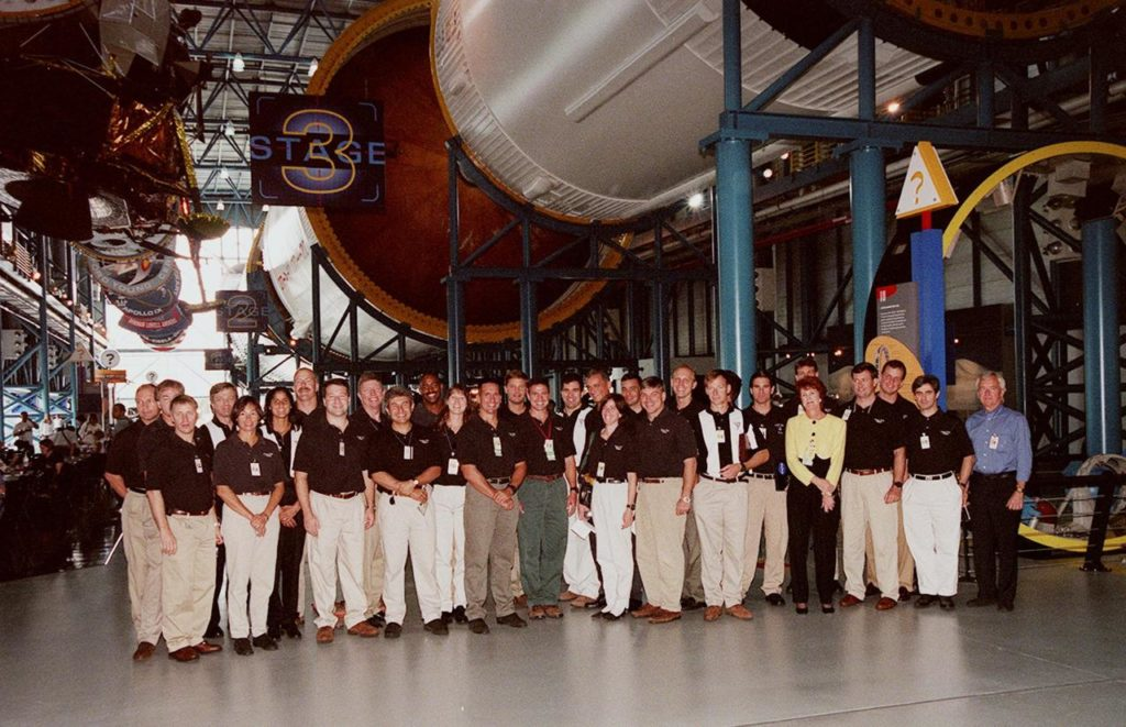 KENNEDY SPACE CENTER, FLA. -- At the Apollo/Saturn V Center, some of the 1998 astronaut candidate class (group 17) line up for a photo during a tour of facilities at KSC. The U.S. candidates include Clayton C. Anderson, Lee J. Archambault, Tracy E. Caldwell (Ph.D.), Gregory E. Chamitoff (Ph.D.), Timothy J. Creamer, Christopher J. Ferguson, Michael J. Foreman, Michael E. Fossum, Kenneth T. Ham, Patricia C. Hilliard (M.D.), Gregory C. Johnson, Gregory H. Johnson, Stanley G. Love (Ph.D.), Leland D. Melvin, Barbara R. Morgan, William A. Oefelein, John D. Olivas (Ph.D.), Nicholas J.M. Patrick (Ph.D.), Alan G. Poindexter, Garrett E. Reisman (Ph.D.), Steven R. Swanson, Douglas H. Wheelock, Sunita L. Williams, Neil W. Woodward III, George D. Zamka; and international candidates Leopold Eyharts, Paolo Nespoli, Hans Schlegel, Roberto Vittori, Bjarni V. Tryggvason, and Marcos Pontes. The class is at KSC for training activities, including fire training and a flight awareness program, plus touring the OPF, SSME Processing Facility, VAB, SSPF, launch pads, SLF and the crew headquarters KSC-99pp1143