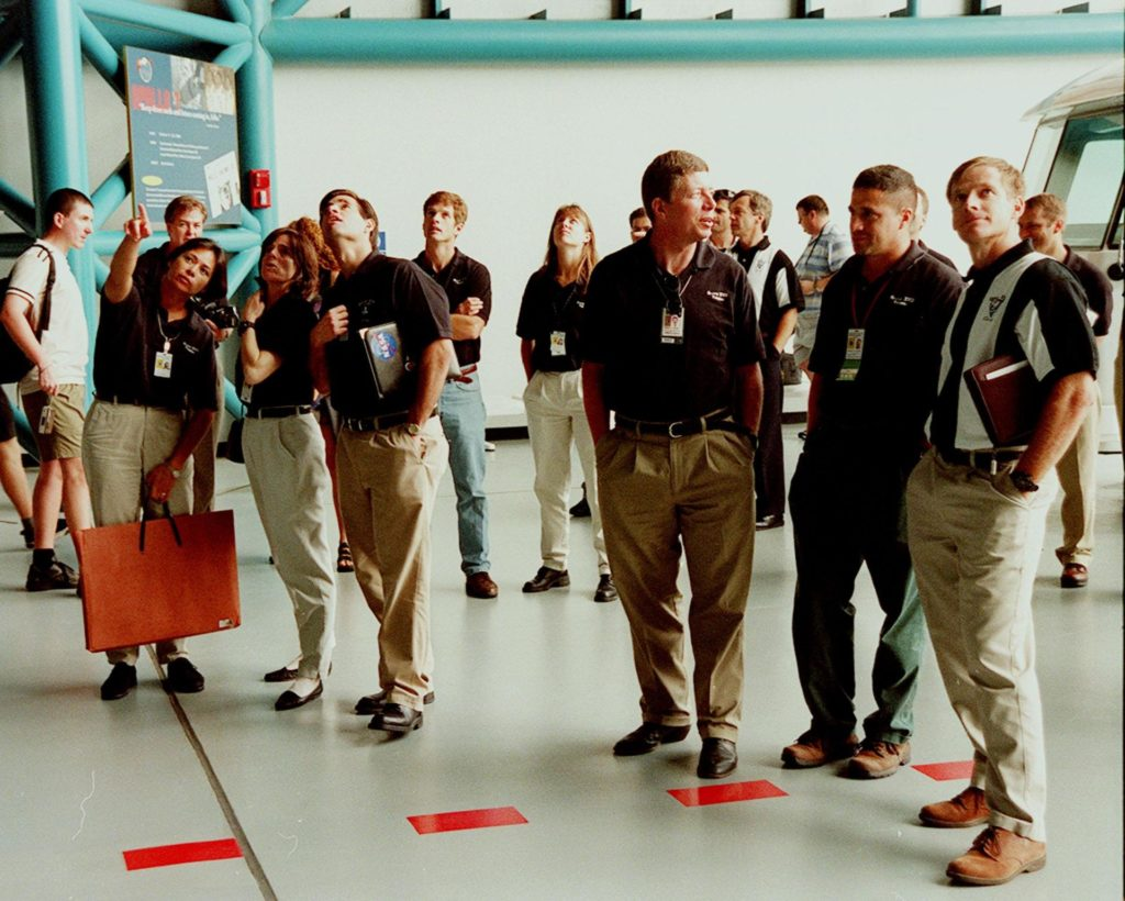 KENNEDY SPACE CENTER, FLA. -- At the Apollo/Saturn V Center, some of the 1998 astronaut candidate class (group 17) take a close look at the Saturn V rocket on display. The U.S. candidates include Clayton C. Anderson, Lee J. Archambault, Tracy E. Caldwell (Ph.D.), Gregory E. Chamitoff (Ph.D.), Timothy J. Creamer, Christopher J. Ferguson, Michael J. Foreman, Michael E. Fossum, Kenneth T. Ham, Patricia C. Hilliard (M.D.), Gregory C. Johnson, Gregory H. Johnson, Stanley G. Love (Ph.D.), Leland D. Melvin, Barbara R. Morgan, William A. Oefelein, John D. Olivas (Ph.D.), Nicholas J.M. Patrick (Ph.D.), Alan G. Poindexter, Garrett E. Reisman (Ph.D.), Steven R. Swanson, Douglas H. Wheelock, Sunita L. Williams, Neil W. Woodward III, George D. Zamka; and international candidates Leopold Eyharts, Paolo Nespoli, Hans Schlegel, Roberto Vittori, Bjarni V. Tryggvason, and Marcos Pontes. The class is at KSC for training activities, including fire training and a flight awareness program, plus touring the OPF, SSME Processing Facility, VAB, SSPF, launch pads, SLF, Apollo/Saturn V Center and the crew headquarters KSC-99pp1145