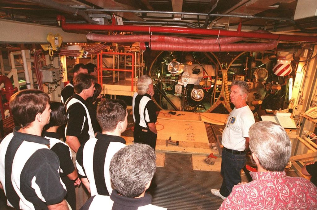 On a raised platform in the Orbiter Processing Facility bay 3, members of the 1998 astronaut candidate class (group 17) look at the aft fuselage of the orbiter Atlantis. The class is at KSC for training activities, including fire training and a flight awareness program, plus touring the OPF, SSME Processing Facility, VAB, SSPF, launch pads, SLF, Apollo/Saturn V Center and the crew headquarters. The U.S. candidates in the '98 class are Clayton C. Anderson, Lee J. Archambault, Tracy E. Caldwell (Ph.D.), Gregory E. Chamitoff (Ph.D.), Timothy J. Creamer, Christopher J. Ferguson, Michael J. Foreman, Michael E. Fossum, Kenneth T. Ham, Patricia C. Hilliard (M.D.), Gregory C. Johnson, Gregory H. Johnson, Stanley G. Love (Ph.D.), Leland D. Melvin, Barbara R. Morgan, William A. Oefelein, John D. Olivas (Ph.D.), Nicholas J.M. Patrick (Ph.D.), Alan G. Poindexter, Garrett E. Reisman (Ph.D.), Steven R. Swanson, Douglas H. Wheelock, Sunita L. Williams, Neil W. Woodward III, George D. Zamka; and the international candidates are Leopold Eyharts, Paolo Nespoli, Hans Schlegel, Roberto Vittori, Bjarni V. Tryggvason, and Marcos Pontes KSC-99pp1148
