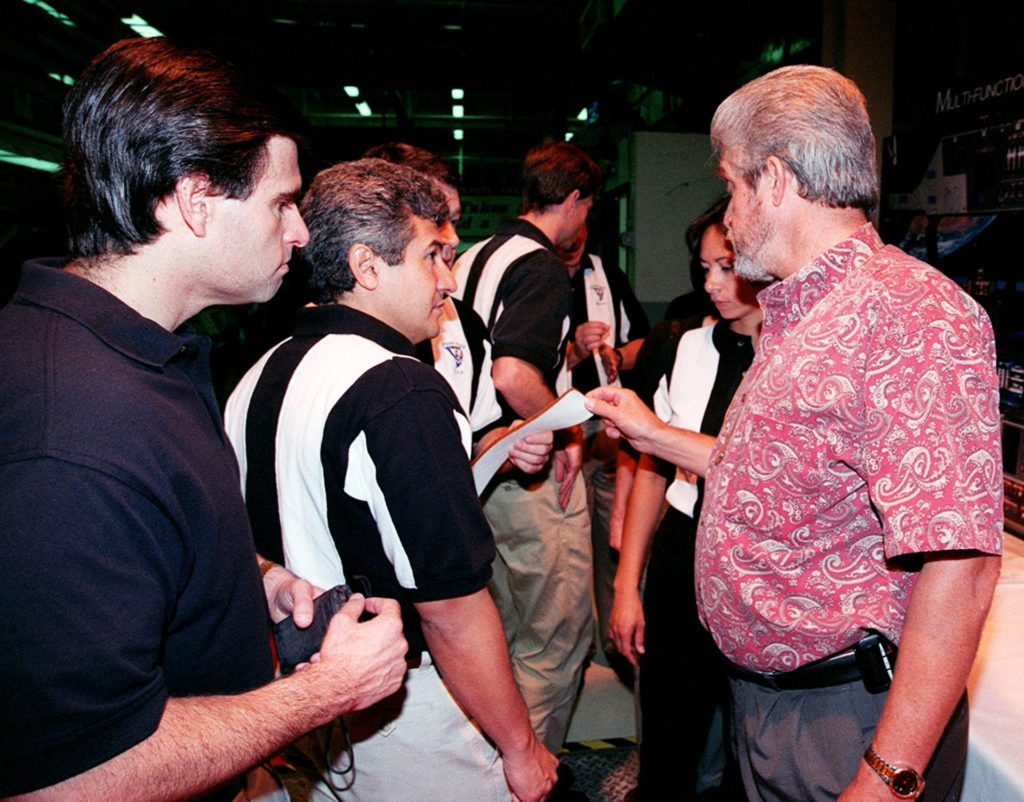 In the Orbiter Processing Facility bay 3, Larry Osheim (right), who is with United Space Alliance, shows members of the 1998 astronaut candidate class (group 17) a sample of Felt Reusable Surface Insulation (FRSI) blankets used on the orbiters. The class is at KSC for training activities, including fire training and a flight awareness program, plus touring the OPF, SSME Processing Facility, VAB, SSPF, launch pads, SLF, Apollo/Saturn V Center and the crew headquarters. The U.S. candidates in the '98 class are Clayton C. Anderson, Lee J. Archambault, Tracy E. Caldwell (Ph.D.), Gregory E. Chamitoff (Ph.D.), Timothy J. Creamer, Christopher J. Ferguson, Michael J. Foreman, Michael E. Fossum, Kenneth T. Ham, Patricia C. Hilliard (M.D.), Gregory C. Johnson, Gregory H. Johnson, Stanley G. Love (Ph.D.), Leland D. Melvin, Barbara R. Morgan, William A. Oefelein, John D. Olivas (Ph.D.), Nicholas J.M. Patrick (Ph.D.), Alan G. Poindexter, Garrett E. Reisman (Ph.D.), Steven R. Swanson, Douglas H. Wheelock, Sunita L. Williams, Neil W. Woodward III, George D. Zamka; and the international candidates are Leopold Eyharts, Paolo Nespoli, Hans Schlegel, Roberto Vittori, Bjarni V. Tryggvason, and Marcos Pontes KSC-99pp1150