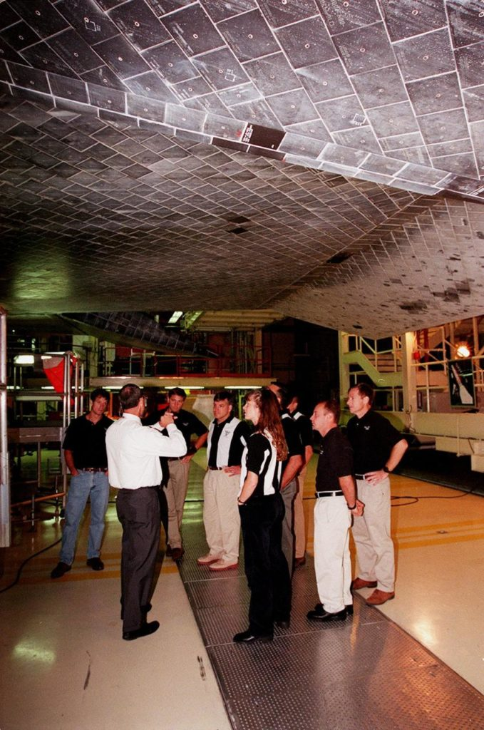 In the Orbiter Processing Facility, members of the 1998 astronaut candidate class (group 17) learn about the thermal protection system on the orbiters, such as Atlantis overhead. The class is at KSC for training activities, including fire training and a flight awareness program, plus touring the OPF, SSME Processing Facility, VAB, SSPF, launch pads, SLF, Apollo/Saturn V Center and the crew headquarters. The U.S. candidates in the '98 class are Clayton C. Anderson, Lee J. Archambault, Tracy E. Caldwell (Ph.D.), Gregory E. Chamitoff (Ph.D.), Timothy J. Creamer, Christopher J. Ferguson, Michael J. Foreman, Michael E. Fossum, Kenneth T. Ham, Patricia C. Hilliard (M.D.), Gregory C. Johnson, Gregory H. Johnson, Stanley G. Love (Ph.D.), Leland D. Melvin, Barbara R. Morgan, William A. Oefelein, John D. Olivas (Ph.D.), Nicholas J.M. Patrick (Ph.D.), Alan G. Poindexter, Garrett E. Reisman (Ph.D.), Steven R. Swanson, Douglas H. Wheelock, Sunita L. Williams, Neil W. Woodward III, George D. Zamka; and the international candidates are Leopold Eyharts, Paolo Nespoli, Hans Schlegel, Roberto Vittori, Bjarni V. Tryggvason, and Marcos Pontes KSC-99pp1151