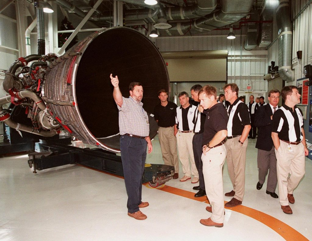 Members of the 1998 astronaut candidate class (group 17) learn about the use of the Space Shuttle Main Engine (SSME) Processing Facility. At left is one of the main shuttle engines. The class is at KSC for training activities, including fire training and a flight awareness program, plus touring the OPF, VAB, SSPF, launch pads, SLF, Apollo/Saturn V Center, the crew headquarters, as well as the SSME Processing Facility. The U.S. candidates in the '98 class are Clayton C. Anderson, Lee J. Archambault, Tracy E. Caldwell (Ph.D.), Gregory E. Chamitoff (Ph.D.), Timothy J. Creamer, Christopher J. Ferguson, Michael J. Foreman, Michael E. Fossum, Kenneth T. Ham, Patricia C. Hilliard (M.D.), Gregory C. Johnson, Gregory H. Johnson, Stanley G. Love (Ph.D.), Leland D. Melvin, Barbara R. Morgan, William A. Oefelein, John D. Olivas (Ph.D.), Nicholas J.M. Patrick (Ph.D.), Alan G. Poindexter, Garrett E. Reisman (Ph.D.), Steven R. Swanson, Douglas H. Wheelock, Sunita L. Williams, Neil W. Woodward III, George D. Zamka; and the international candidates are Leopold Eyharts, Paolo Nespoli, Hans Schlegel, Roberto Vittori, Bjarni V. Tryggvason, and Marcos Pontes KSC-99pp1153