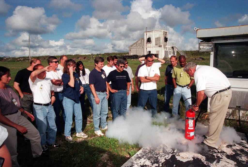 KENNEDY SPACE CENTER, FLA. -- On the grounds of the Kennedy Space Center, members of the 1998 astronaut candidate class (Group 17) take part in fire training. The class is taking part in training activities, including a flight awareness program, plus touring the OPF, VAB, SSPF, SSME Processing Facility, launch pads, SLF, Apollo/Saturn V Center, and the crew quarters. The U.S. candidates in the '98 class are Clayton C. Anderson, Lee J. Archambault, Tracy E. Caldwell (Ph.D.), Gregory E. Chamitoff (Ph.D.), Timothy J. Creamer, Christopher J. Ferguson, Michael J. Foreman, Michael E. Fossum, Kenneth T. Ham, Patricia C. Hilliard (M.D.), Gregory C. Johnson, Gregory H. Johnson, Stanley G. Love (Ph.D.), Leland D. Melvin, Barbara R. Morgan, William A. Oefelein, John D. Olivas (Ph.D.), Nicholas J.M. Patrick (Ph.D.), Alan G. Poindexter, Garrett E. Reisman (Ph.D.), Steven R. Swanson, Douglas H. Wheelock, Sunita L. Williams, Neil W. Woodward III, George D. Zamka; and the international candidates are Leopold Eyharts, Paolo Nespoli, Hans Schlegel, Roberto Vittori, Bjarni V. Tryggvason, and Marcos Pontes KSC-99pp1158