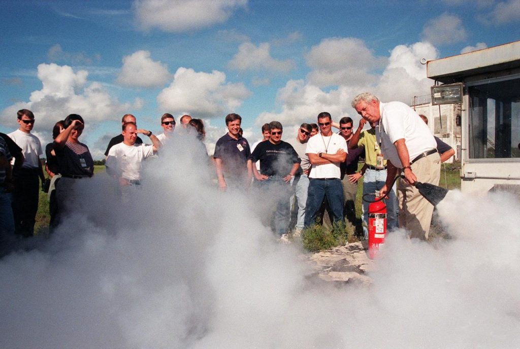 KENNEDY SPACE CENTER, FLA. -- On the grounds of the Kennedy Space Center, members of the 1998 astronaut candidate class (Group 17) watch a demonstration as part of fire training. The class is taking part in training activities, including a flight awareness program, plus touring the OPF, VAB, SSPF, SSME Processing Facility, launch pads, SLF, Apollo/Saturn V Center, and the crew quarters. The U.S. candidates in the '98 class are Clayton C. Anderson, Lee J. Archambault, Tracy E. Caldwell (Ph.D.), Gregory E. Chamitoff (Ph.D.), Timothy J. Creamer, Christopher J. Ferguson, Michael J. Foreman, Michael E. Fossum, Kenneth T. Ham, Patricia C. Hilliard (M.D.), Gregory C. Johnson, Gregory H. Johnson, Stanley G. Love (Ph.D.), Leland D. Melvin, Barbara R. Morgan, William A. Oefelein, John D. Olivas (Ph.D.), Nicholas J.M. Patrick (Ph.D.), Alan G. Poindexter, Garrett E. Reisman (Ph.D.), Steven R. Swanson, Douglas H. Wheelock, Sunita L. Williams, Neil W. Woodward III, George D. Zamka; and the international candidates are Leopold Eyharts, Paolo Nespoli, Hans Schlegel, Roberto Vittori, Bjarni V. Tryggvason, and Marcos Pontes KSC-99pp1159