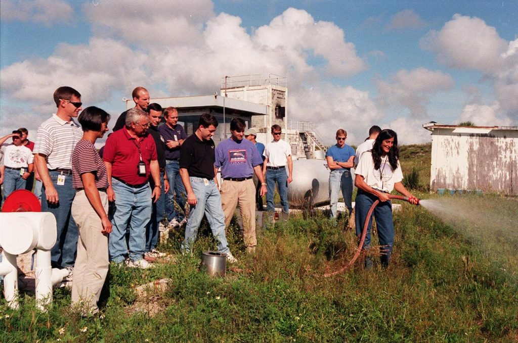 KENNEDY SPACE CENTER, FLA. -- On the grounds of the Kennedy Space Center, members of the 1998 astronaut candidate class (Group 17) watch as candidate Sunita L. Williams practices using firefighting equipment during fire training. The class is at KSC for training activities, including a flight awareness program, plus touring the OPF, VAB, SSPF, SSME Processing Facility, launch pads, SLF, Apollo/Saturn V Center, and the crew quarters. The other U.S. candidates in the '98 class are Clayton C. Anderson, Lee J. Archambault, Tracy E. Caldwell (Ph.D.), Gregory E. Chamitoff (Ph.D.), Timothy J. Creamer, Christopher J. Ferguson, Michael J. Foreman, Michael E. Fossum, Kenneth T. Ham, Patricia C. Hilliard (M.D.), Gregory C. Johnson, Gregory H. Johnson, Stanley G. Love (Ph.D.), Leland D. Melvin, Barbara R. Morgan, William A. Oefelein, John D. Olivas (Ph.D.), Nicholas J.M. Patrick (Ph.D.), Alan G. Poindexter, Garrett E. Reisman (Ph.D.), Steven R. Swanson, Douglas H. Wheelock, Neil W. Woodward III, George D. Zamka; and the international candidates are Leopold Eyharts, Paolo Nespoli, Hans Schlegel, Roberto Vittori, Bjarni V. Tryggvason, and Marcos Pontes KSC-99pp1161