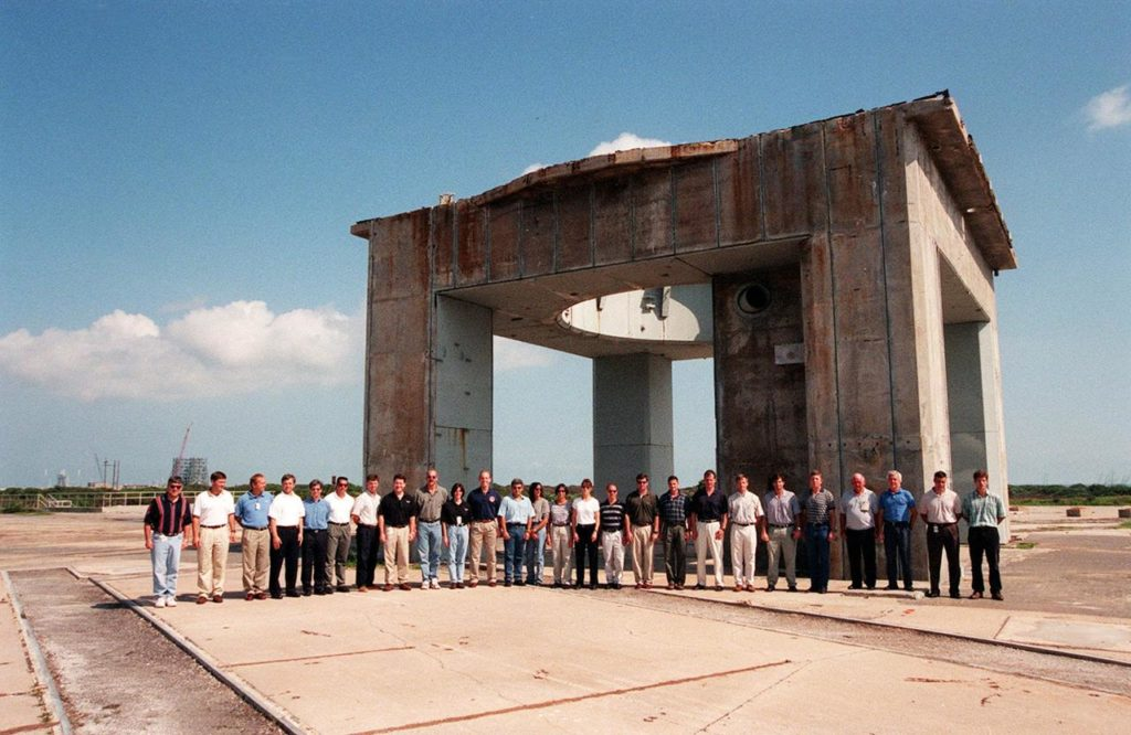 At Cape Canaveral Air Station, members of the 1998 astronaut candidate class (Group 17) pose in front of what remains of the launch tower at Launch Complex 34 during a tour of the station's facilities. During the Apollo Program, Launch Complex 34 was the site of the first Saturn I and Saturn IB launches, as well as the tragic fire in which the Apollo I astronauts lost their lives. The class is at Kennedy Space Center taking part in training activities, including a flight awareness program, as well as touring the OPF, VAB, SSPF, SSME Processing Facility, launch pads, SLF, Apollo/Saturn V Center, and the crew quarters. The U.S. candidates in the '98 class are Clayton C. Anderson, Lee J. Archambault, Tracy E. Caldwell (Ph.D.), Gregory E. Chamitoff (Ph.D.), Timothy J. Creamer, Christopher J. Ferguson, Michael J. Foreman, Michael E. Fossum, Kenneth T. Ham, Patricia C. Hilliard (M.D.), Gregory C. Johnson, Gregory H. Johnson, Stanley G. Love (Ph.D.), Leland D. Melvin, Barbara R. Morgan, William A. Oefelein, John D. Olivas (Ph.D.), Nicholas J.M. Patrick (Ph.D.), Alan G. Poindexter, Garrett E. Reisman (Ph.D.), Steven R. Swanson, Douglas H. Wheelock, Sunita L. Williams, Neil W. Woodward III, George D. Zamka; and the international candidates are Leopold Eyharts, Paolo Nespoli, Hans Schlegel, Roberto Vittori, Bjarni V. Tryggvason, and Marcos Pontes KSC-99pp1172
