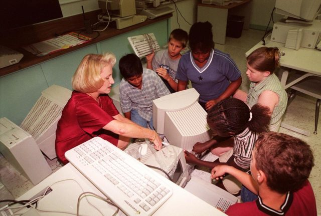 Nancy Nichols, principal of South Lake Elementary School, Titusville, Fla., joins students in teacher Michelle Butler's sixth grade class who are unwrapping computer equipment donated by Kennedy Space Center. South Lake is one of 13 Brevard County schools receiving 81 excess contractor computers thanks to an innovative educational outreach project spearheaded by the Nasa k-12 Education Services Office at ksc. The Astronaut Memorial Foundation, a strategic partner in the effort, and several schools in rural Florida and Georgia also received refurbished computers as part of the year-long project. KSC employees put in about 3,300 volunteer hours to transform old, excess computers into upgraded, usable units. A total of $90,000 in upgraded computer equipment is being donated KSC-99pp1226