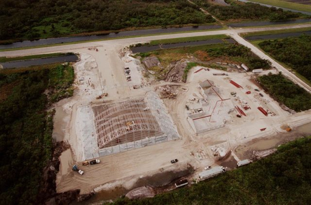 Construction continues on an $8 million Reusable Launch Vehicle (RLV) Support Complex at Kennedy Space Center. At left is a multi-purpose hangar and at right a building for related ground support equipment and administrative/ technical support. The complex is situated at the Shuttle Landing Facility (upper right). Near the top of the photo is the tow-way. The RLV complex will be available to accommodate the Space Shuttle; the X-34 RLV technology demonstrator; the L-1011 carrier aircraft for Pegasus and X-34; and other RLV and X-vehicle programs. The complex is jointly funded by the Spaceport Florida Authority, NASA's Space Shuttle Program and KSC. The facility will be operational in early 2000 KSC-99pp1209