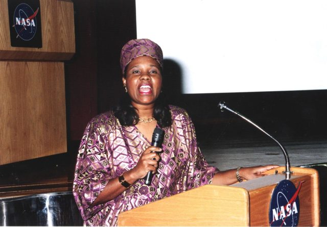 """Clothed in her traditional African garb, Michelle Amos, mistress of ceremonies, welcomes the audience on Feb. 3 at the kick-off of African-American History Month. The theme for this year's observation is """"Heritage and Horizons: The African-American Legacy and the Challenges of the 21st Century."""" February is designated each year as a time to celebrate the achievements and contributions of African Americans to Kennedy Space Center, NASA and the nation KSC-00pp0158"""