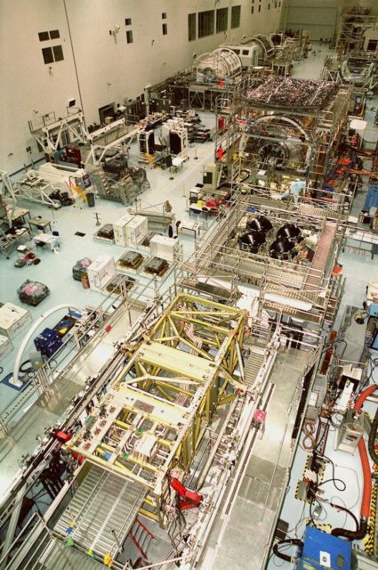 KENNEDY SPACE CENTER, FLA. -- The floor of the Space Station Processing Facility is filled with racks and hardware for testing the various components of the International Space Station (ISS). The large module in the center of the floor (top) is the U.S. Lab, Destiny. The U.S. Laboratory module continues a long tradition of microgravity materials research, first conducted by Skylab and later Shuttle and Spacelab missions. Destiny is expected to be a major feature in future research, providing facilities for biotechnology, fluid physics, combustion, and life sciences research. It is scheduled to be launched on mission STS-98 (no date determined yet for launch). At top left are the Multi-Purpose Logistics Modules Raffaello and Leonardo and the Pressurized Mating Adapter-3 (PMA-3). Italy's major contributions to the ISS program, Raffaello and Leonardo are reusable logistics carriers to resupply and return Station cargo requiring a pressurized environment. They are slated as payloads on missions STS-102 and STS-100, respectively. Dates have not yet been determined for the two missions. The PMA-3, once launched, will be mated to Node 1, a connecting passageway to the living and working areas of the Space Station. The primary purpose of PMA-3 is to serve as a Shuttle docking port through which crew members and equipment will transfer to the Space Station during later assembly missions. PMA-3 is scheduled as payload on mission STS-92, whose date for launch is not yet determined KSC-00pp0297