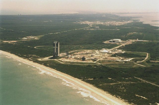 Looking from the east, over the Atlantic Ocean, this aerial view shows the construction on Launch Complex 41, Cape Canaveral Air Force Station, previously used to launch 17 Titan III and 10 Titan IV rockets. Lockheed Martin Astronautics razed the old towers that supported their last Titan launch in April 1999 to make way for construction of this new Atlas V launch facility. The launch pad abuts the Atlantic Ocean on the east, seen here in the foreground. KSC-00PP-0432
