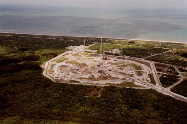 This aerial view from the west looks over the construction on Launch Complex 41, Cape Canaveral Air Force Station, previously used to launch 17 Titan III and 10 Titan IV rockets. Lockheed Martin Astronautics razed the old towers that supported their last Titan launch in April 1999 to make way for construction of this new Atlas V launch facility. The launch pad abuts the Atlantic Ocean on the east, seen here in the background KSC00pp0430