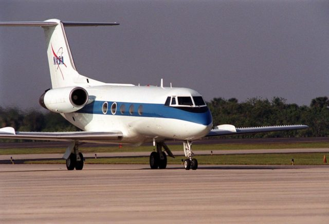 A Shuttle Training Aircraft (STA) taxis into the parking area of KSC's Shuttle Landing Facility. The STA is a modified Grumman American Aviation-built Gulfstream II executive jet that was modified to simulate an orbiter's cockpit, motion and visual cues, and handling qualities. It is used by Shuttle flight crews to practice landing the orbiter. In flight, the STA duplicates the orbiter's atmospheric descent trajectory from approximately 35,000 feet altitude to landing on a runway. The orbiter differs in at least one major aspect from conventional aircraft; it is unpowered during re-entry and landing so its high-speed glide must be perfectly executed the first time there is no go-around capability. The orbiter touchdown speed is 213 to 226 miles (343 to 364 kilometers) per hour. There are two STAs, based in Houston KSC-00pp0604