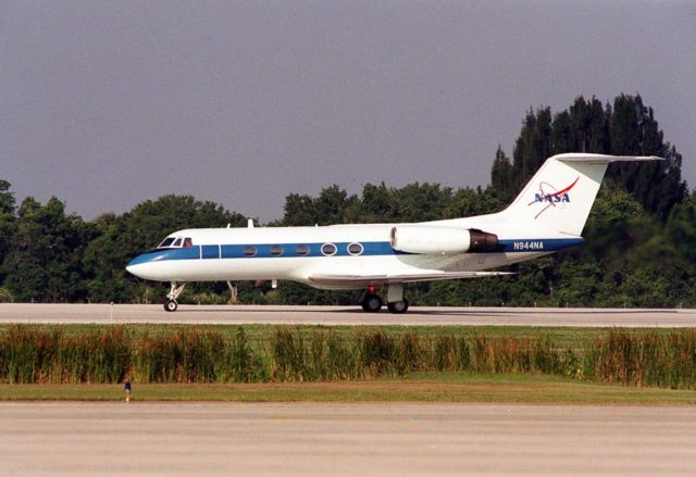 A Shuttle Training Aircraft (STA) taxis down the runway at KSC's Shuttle Landing Facility. The STA is a modified Grumman American Aviation-built Gulfstream II executive jet that was modified to simulate an orbiter's cockpit, motion and visual cues, and handling qualities. It is used by Shuttle flight crews to practice landing the orbiter. In flight, the STA duplicates the orbiter's atmospheric descent trajectory from approximately 35,000 feet altitude to landing on a runway. The orbiter differs in at least one major aspect from conventional aircraft; it is unpowered during re-entry and landing so its high-speed glide must be perfectly executed the first time there is no go-around capability. The orbiter touchdown speed is 213 to 226 miles (343 to 364 kilometers) per hour. There are two STAs, based in Houston KSC00pp0602