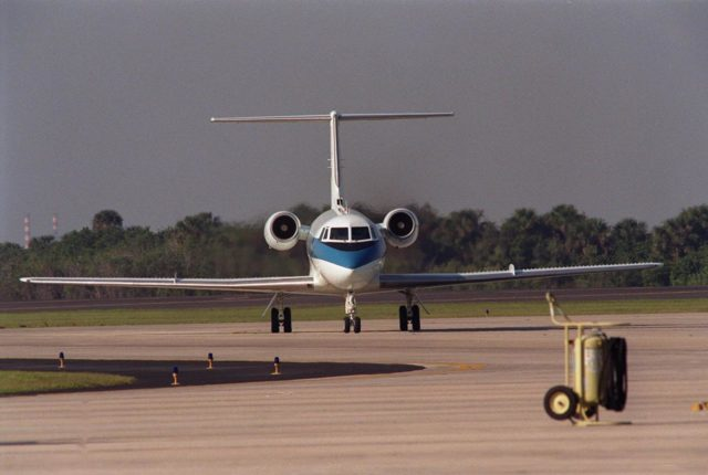 A Shuttle Training Aircraft (STA) taxis into the parking area of KSC's Shuttle Landing Facility. The STA is a modified Grumman American Aviation-built Gulfstream II executive jet that was modified to simulate an orbiter's cockpit, motion and visual cues, and handling qualities. It is used by Shuttle flight crews to practice landing the orbiter. In flight, the STA duplicates the orbiter's atmospheric descent trajectory from approximately 35,000 feet altitude to landing on a runway. The orbiter differs in at least one major aspect from conventional aircraft; it is unpowered during re-entry and landing so its high-speed glide must be perfectly executed the first time there is no go-around capability. The orbiter touchdown speed is 213 to 226 miles (343 to 364 kilometers) per hour. There are two STAs, based in Houston KSC00pp0603