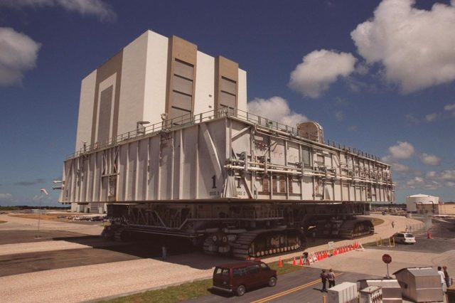 KENNEDY SPACE CENTER, FLA. -- A crawler-transporter with mobile launcher platform on top moves along a portion of the once-buried crawlerway toward the Vehicle Assembly Building (VAB). The road was restored as part of KSC's Safe Haven project. High bay 2 provides a third stacking area. The primary goal of the Safe Haven construction project was to strengthen readiness for hurricane season by expanding the VAB's storage capacity. The new area, in high bay 2, will allow NASA to preassemble stacks and still have room in the VAB to pull a Shuttle back from the pad if severe weather threatens. Potential rollouts of the Space Shuttle to the launch pad from high bay 2 will involve making a turn around the north side of the VAB in contrast to the straight rollouts from high bays 1 and 3, on the east side of the VAB facing the launch pads KSC-00pp0718