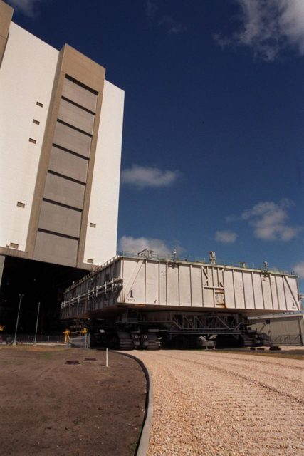 KENNEDY SPACE CENTER, FLA. -- A mobile launcher platform atop a crawler-transporter, heads to the open door of the Vehicle Assembly Building high bay 2. As part of the Safe Haven project, a once-buried portion of the crawlerway was restored to enable rollout of a Shuttle from this third stacking area. The primary goal of the Safe Haven construction project was to strengthen readiness for hurricane season by expanding the VAB's storage capacity. The new area, in high bay 2, will allow NASA to preassemble stacks and still have room in the VAB to pull a Shuttle back from the pad if severe weather threatens. Potential rollouts of the Space Shuttle to the launch pad from high bay 2 will involve making a turn around the north side of the VAB in contrast to the straight rollouts from high bays 1 and 3, on the east side of the VAB facing the launch pads KSC-00pp0720