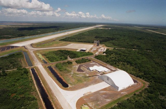 In the foreground of this aerial photo is the Reusable Launch Vehicle (RLV) Support Complex at Kennedy Space Center. At right is a multi-purpose hangar and to its left is a building for related ground support equipment and administrative/ technical support. The complex is situated at the Shuttle Landing Facility (center). At the upper left is the runway. The RLV complex will be available to accommodate the Space Shuttle; the X-34 RLV technology demonstrator; the L-1011 carrier aircraft for Pegasus and X-34; and other RLV and X-vehicle programs. The complex is jointly funded by the Spaceport Florida Authority, NASA's Space Shuttle Program and KSC KSC00pp0724